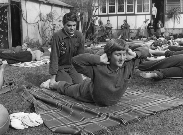 Pat Hungerford and Lorraine Crapp calisthenics in Thicknesse backyard, 1955