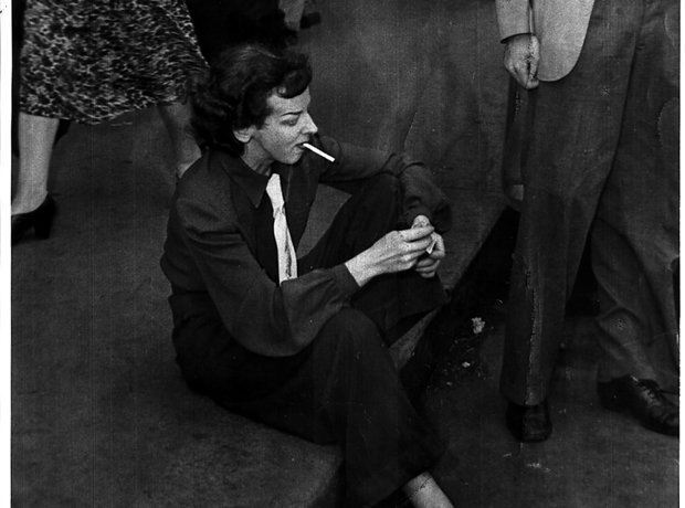 Rosaleen Norton sitting in the gutter and smoking